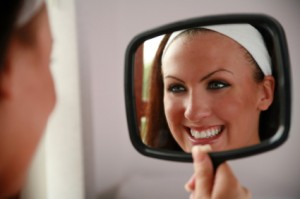 rp_woman-looking-in-mirror-smiling-300x199.jpg