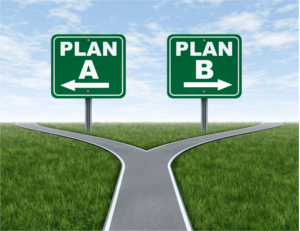 Cross roads with plan A plan B road signs business symbol represnting the difficult choices and challenges when selecting the right strategic path to take on a