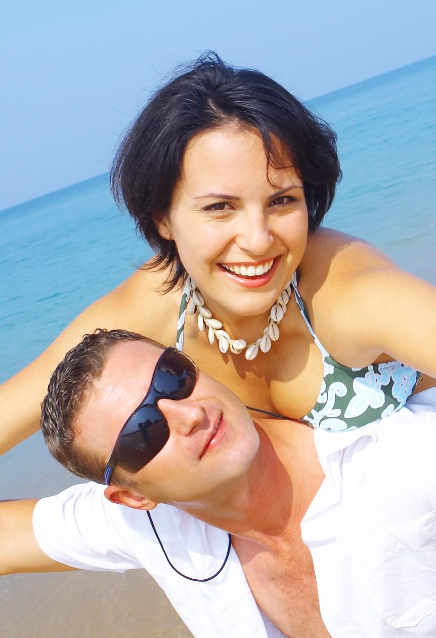 Couple-on-beach-piggyback
