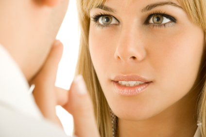 Woman looking intently at man