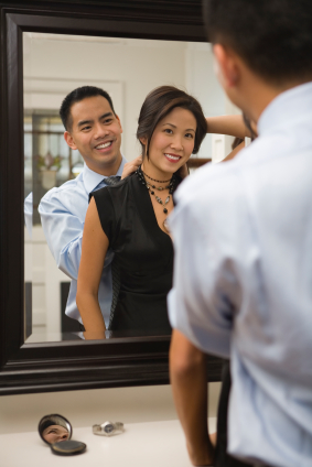 Young couple getting ready for night out